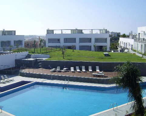 Large communal swimming pool, landscaped gardens and sun terrace sunloungers