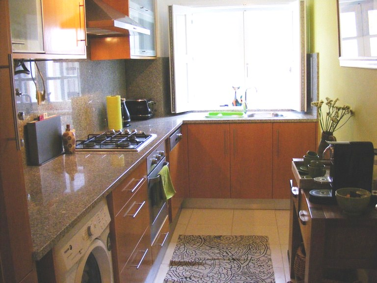 Large, fully equipped kitchen with granite worktop