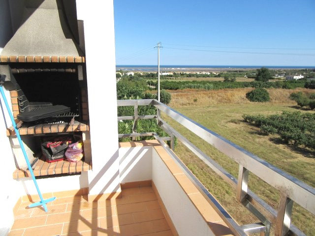 Balcony next to kitchen with fitted BBQ
