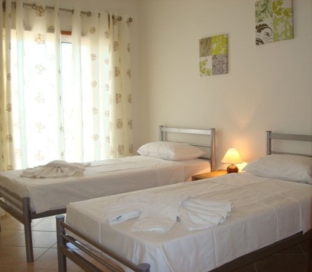 Spacious double bedroom with twin beds and wardrobes