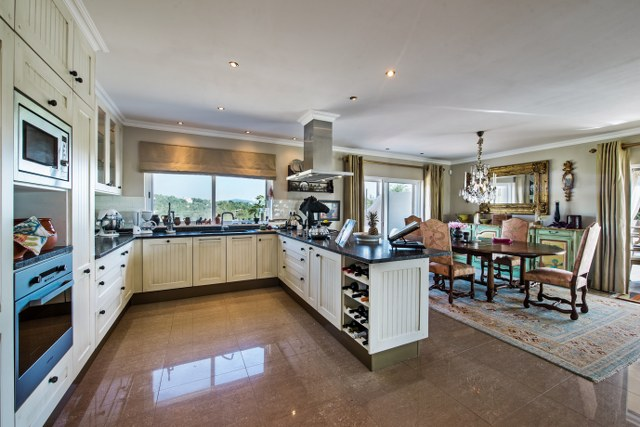 Spacious open plan design kitchen with cooking island and high quality kitchen equipment