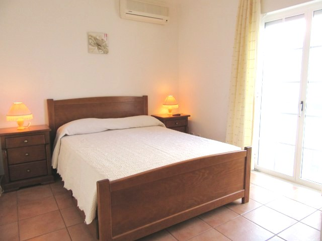Spacious double bedroom with air conditioning and built in wardrobes