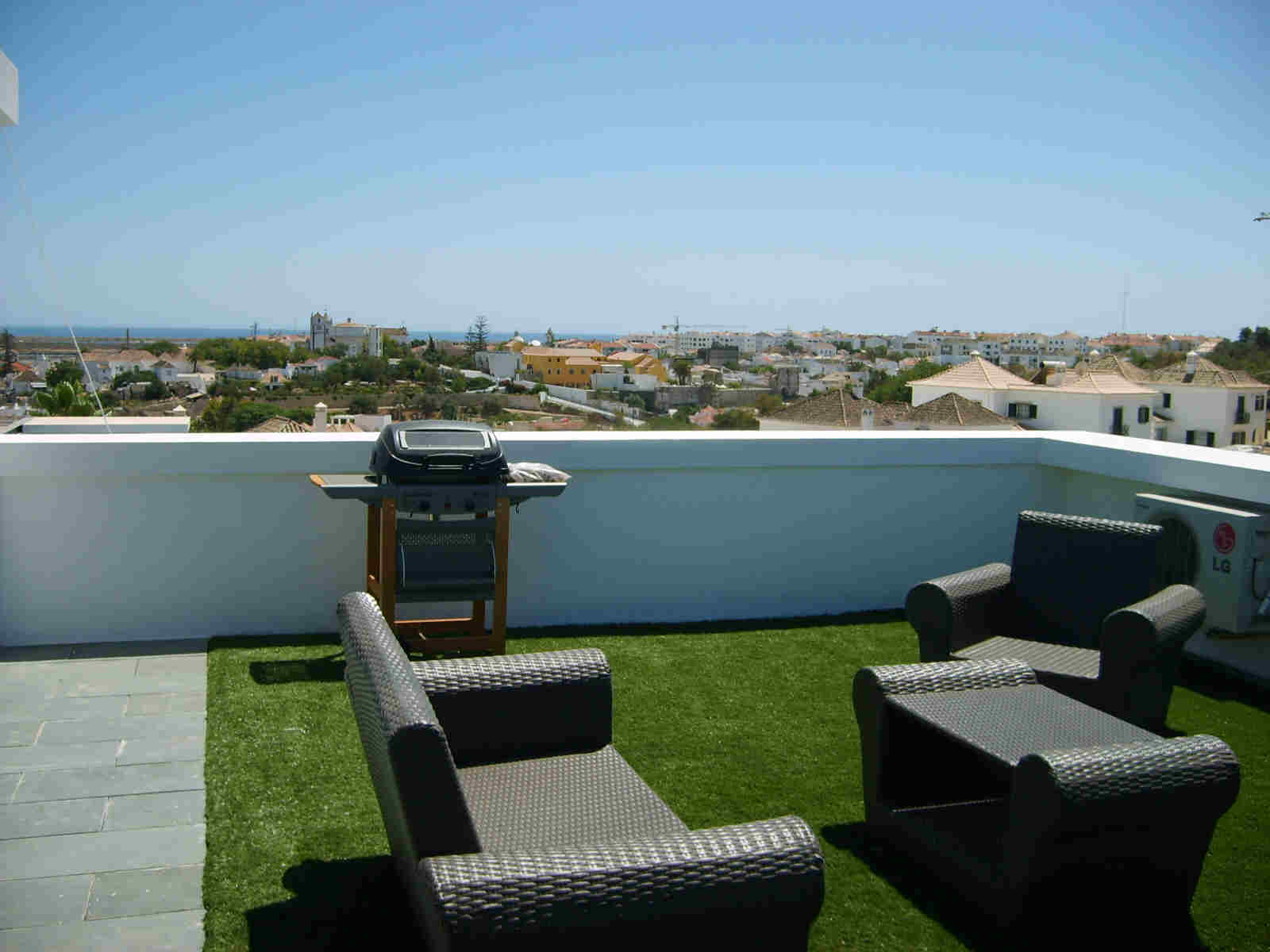 BBQ area on Private roof terrace with table & chairs