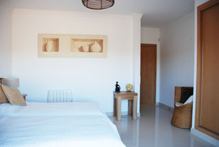 Spacious bedroom with twin beds and en suite bathroom