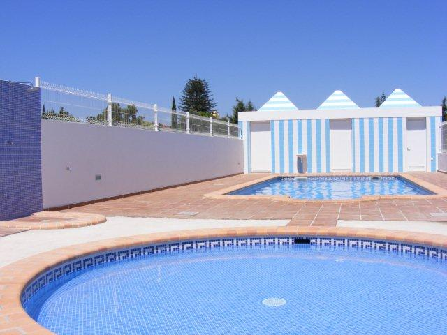 Communal swimming pool with outside shower, bathrooms and todler pool