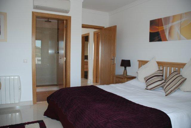Spacious double bedroom with en suite bathroom